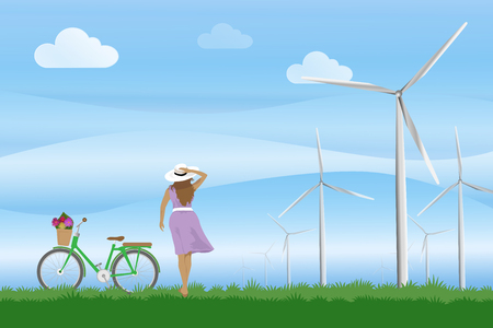 A girl with bike and bear watching the blue sky with wind mills