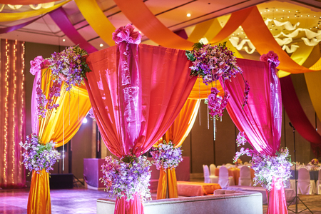 The colorful stage decoration with bright shade of color for bride and groom in the sangeet night of traditional Indian wedding Stock Photo