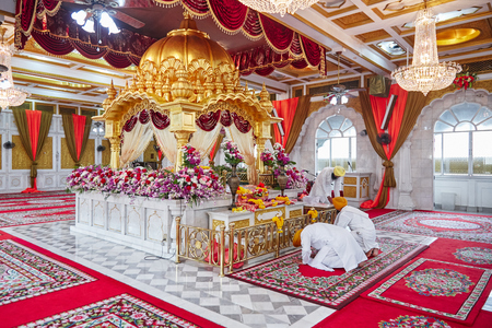 BANGKOK, THAILAND - DECEMBER 13, 2014: Gudwara Sri Guru Sing Saba is the beautiful Sikh temple in Bangkok, Thailand, The altar with golden color and red velvet decoration, the place of worship.
