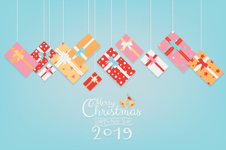 Colorful Christmas and Happy New Year 2019 banner design with gifts box hanging and calligraphy hand writing script on sweet green background with copy space. Vector illustration.