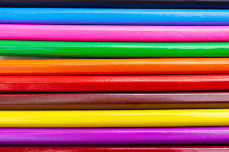 Closeup colorful crayon pencils with rainbow color abstract background textured in horizontal.