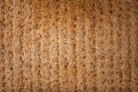 Dried straw, grass thatch plants pack for wall, roof, countryside hut. Nature abstract textured background. Stockfoto