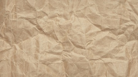Abstract crinkle crumpled kraft paper background, brown paper rumple with textured Imagens