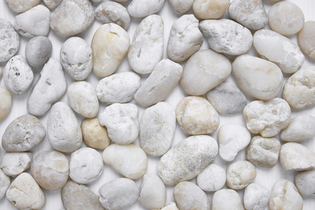 White pebbles stone texture background in different size view from above, closeup Reklamní fotografie