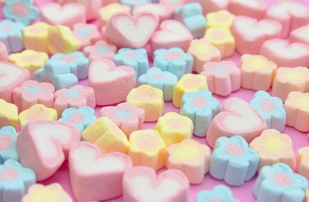 Selective focus, Close-up a bunch of colorful, pastel, sweet color of sweet candy marshmallows on the pink background for web banner, brochure, leaflet, flyer template design