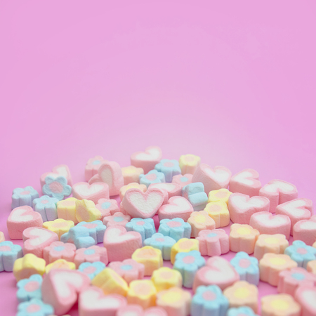 Selective focus a group of pastel sweet colorful candy marshmallows on pink background with copy space for square web banner, brochure, leaflet, flyer, advertisement template or recipe menu design 스톡 콘텐츠