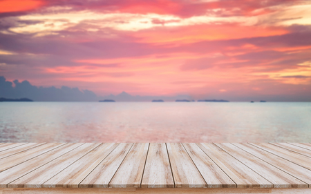 Empty wooden board with orange sky sunset nature background, Travel, Summer, Lifestyle concept can use for mock-up, design key visual layout, montage products display. 版權商用圖片