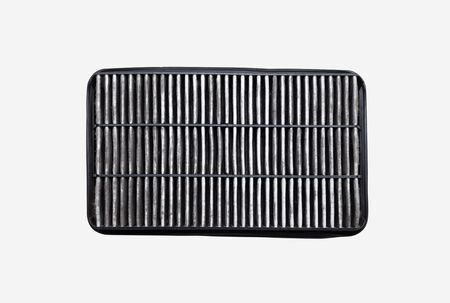The bottom side of the dirty car air filter with dust isolated on white