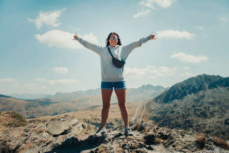 Happy 20-year-old girl on top of a mountain in Andorra.