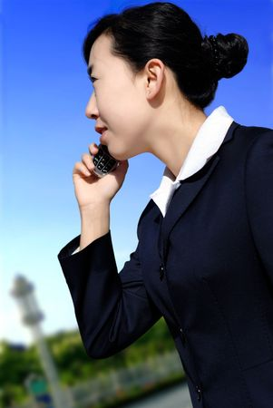 Beautiful businesswoman make call by mobile cell phone. Outdoor, over city. Stock Photo - 11682636
