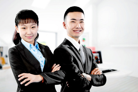 The image of the two young business people in the office photo