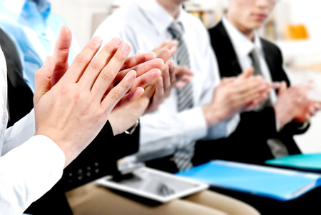 Close-up of business people clapping hands  photo