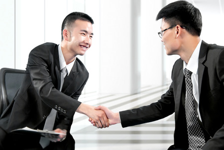 Business people shaking hands photo