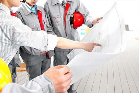 Construction personnel in the drawings photo