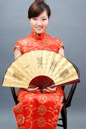 wedding customs: Chinese girl holding a fan Stock Photo