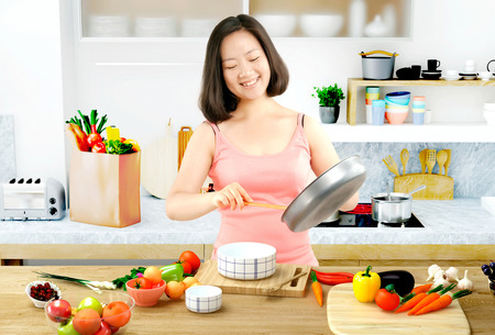 A young woman in the kitchen preparing food photo