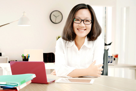 Young pretty business woman with notebook in the office photo