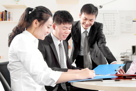 file clerks: Business people in office meeting to discuss