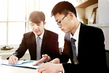 adult vietnam: Young employees in the office to discuss