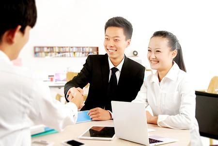 entrepreneur: Business people shaking hands