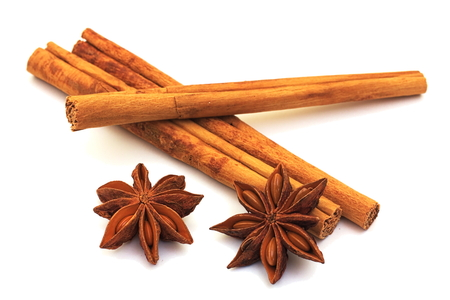 Three cinnamon sticks with star-anise isolated on white  photo