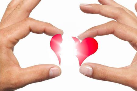 Two hands unite a broken heart