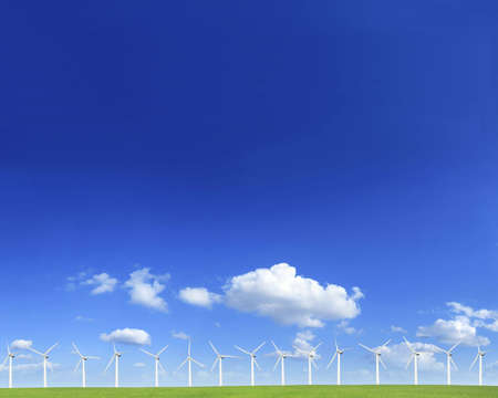 Windmills on a green hill in a sunny day