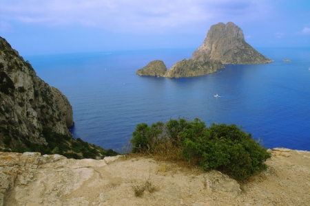 vedra: View of the gigantic and the legendary isle of Es Vedra in the south west of the Balearic island of Ibiza in the Mediterranean Stock Photo