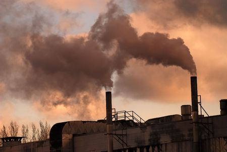 Dark smoke from a smokestack. photo