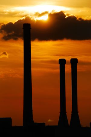 Chimneys in the sunset. photo