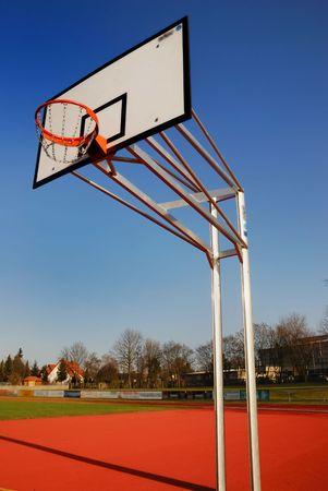 Basketball board against blue sky. photo