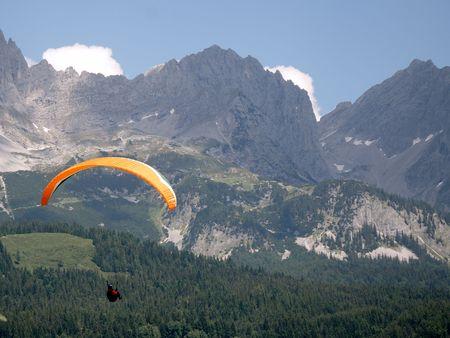 Paraglider at the Wilder Kaiser mountains in austria. photo
