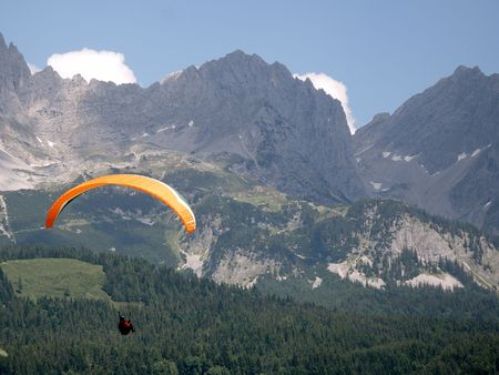 audacious: Paraglider at the Wilder Kaiser mountains in austria.
