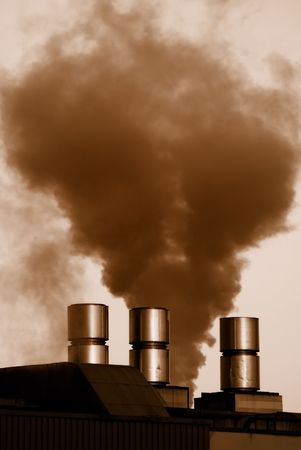Dark smoke at a smokestack. photo