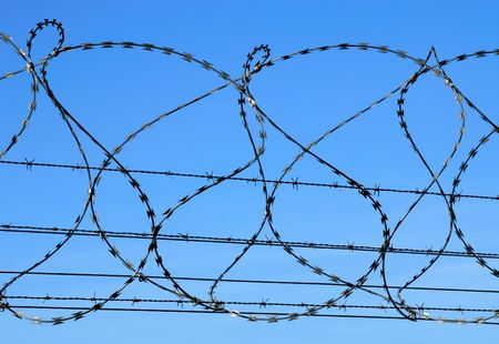 Barbed wire against blue sky. Stock Photo - 2982671