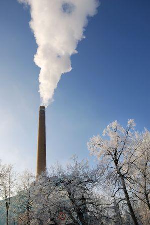 smokestack: Dark smoke at a smokestack.