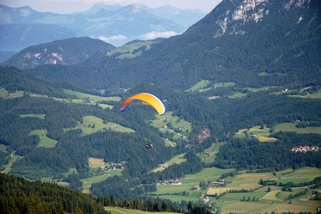 audacious: Paraglider in the austrian alps.