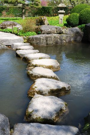 Stone path in a japanese water garden Stock Photo