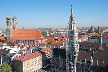 City house of Munich at the Marienplatz and the church of our lady Stock Photo