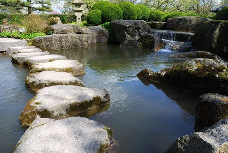 Stone path in a japanese water garden photo