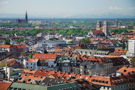 View over the city of Munich with the alps in the background