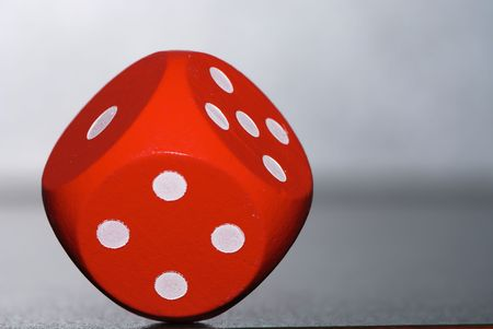 Gambling with a red rolling dice photo