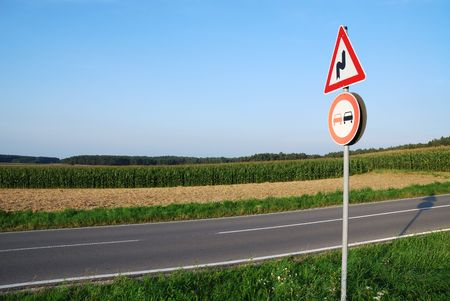 Landscape with a traffic sign: Dont overtake because of curves. photo