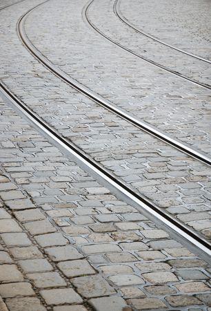 Tram tracks on grey cobblestone photo