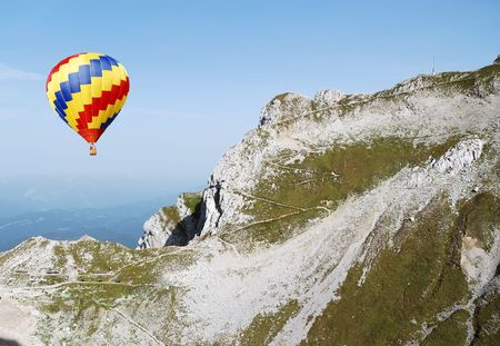 Hot air balloon in the alps Stock Photo