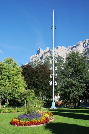 maypole: Maypole of the village Mittenwald at the Karwendel mountains (Bavaria, Germany) Stock Photo