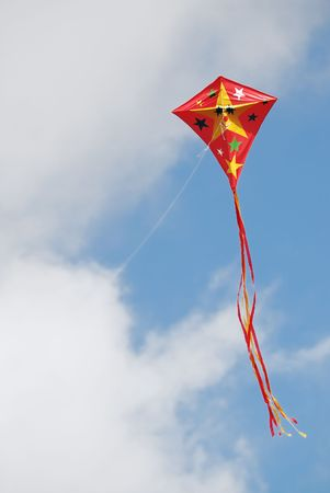 flying a kite: Funny red kite flying in the sky Stock Photo