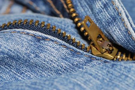 half open: half open zipper of a blue jeans