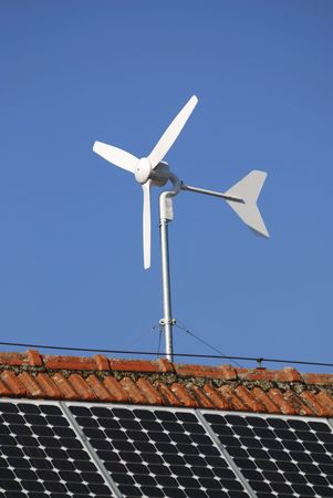 Alternative energy with solar panels and a wind engine photo