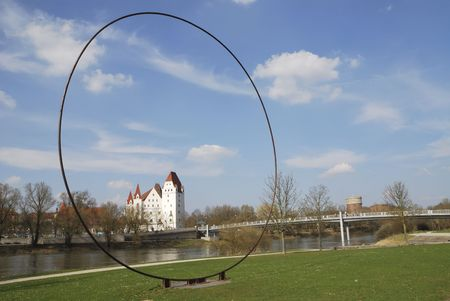 Castle of Ingolstadt seen through a metal ring sculpture. Stock Photo - 5227551